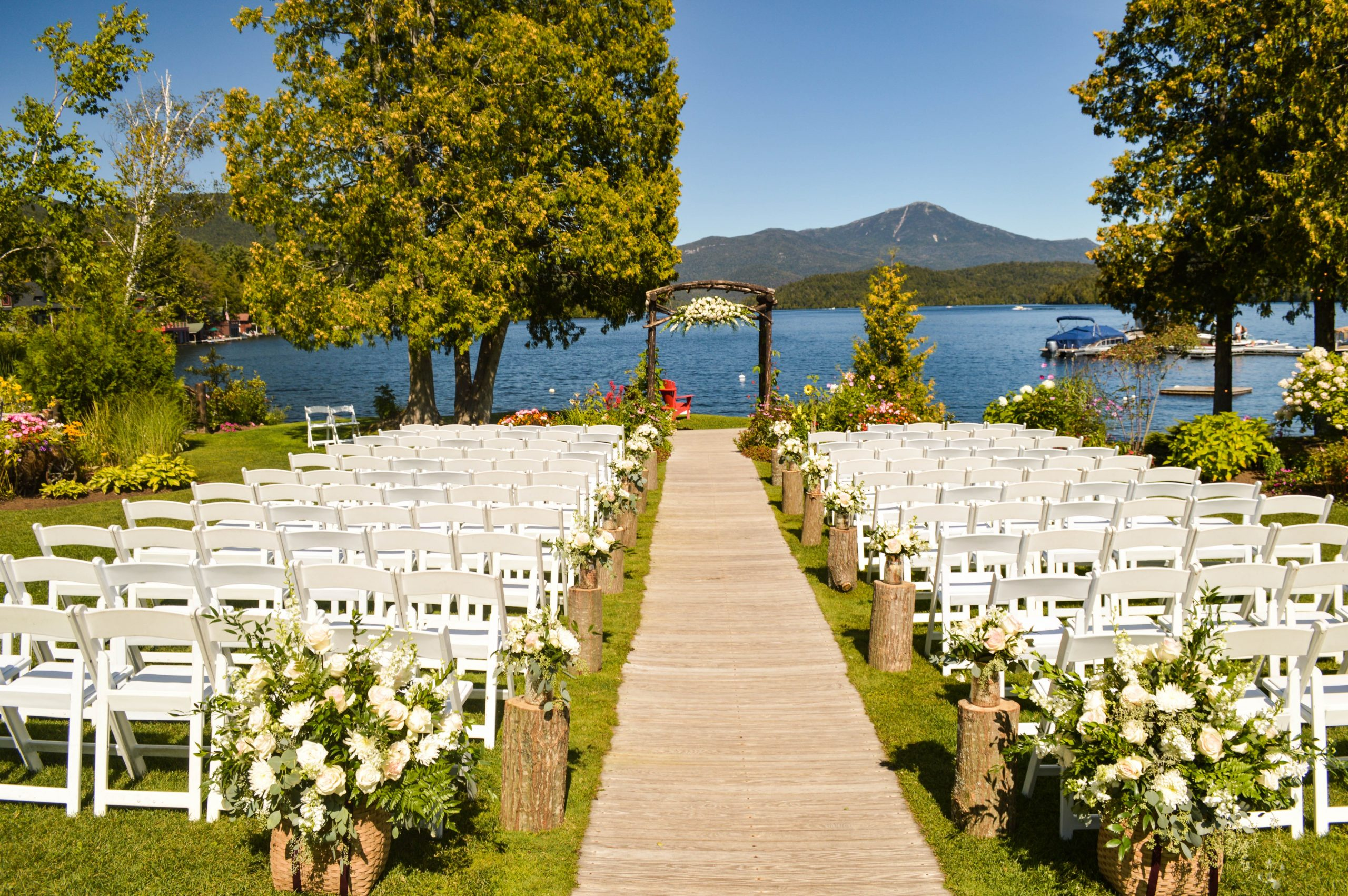outdoor wedding venue with chairs and alter overlooking lake