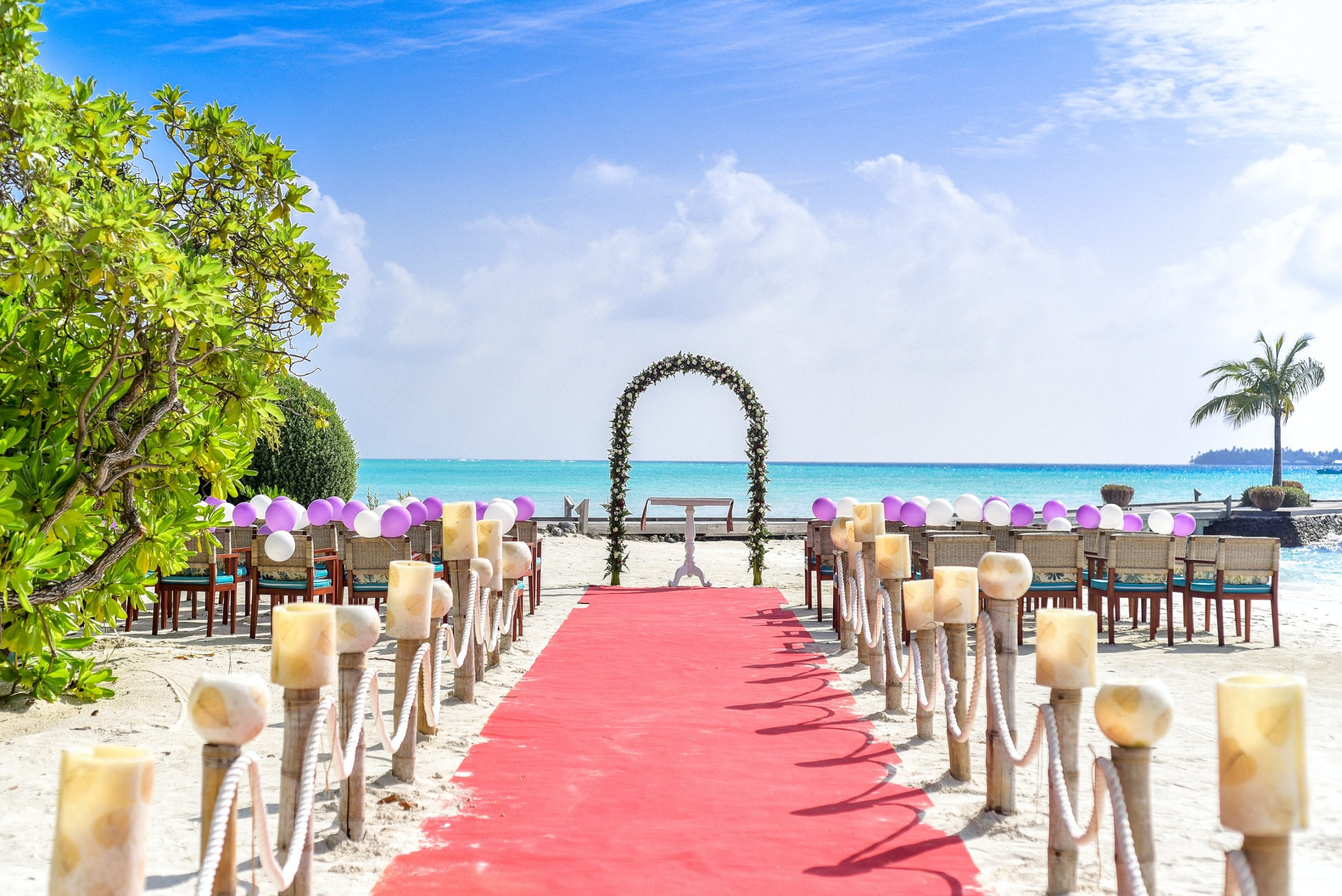 Beach wedding with aisle and seats leading out to ocean horizon.