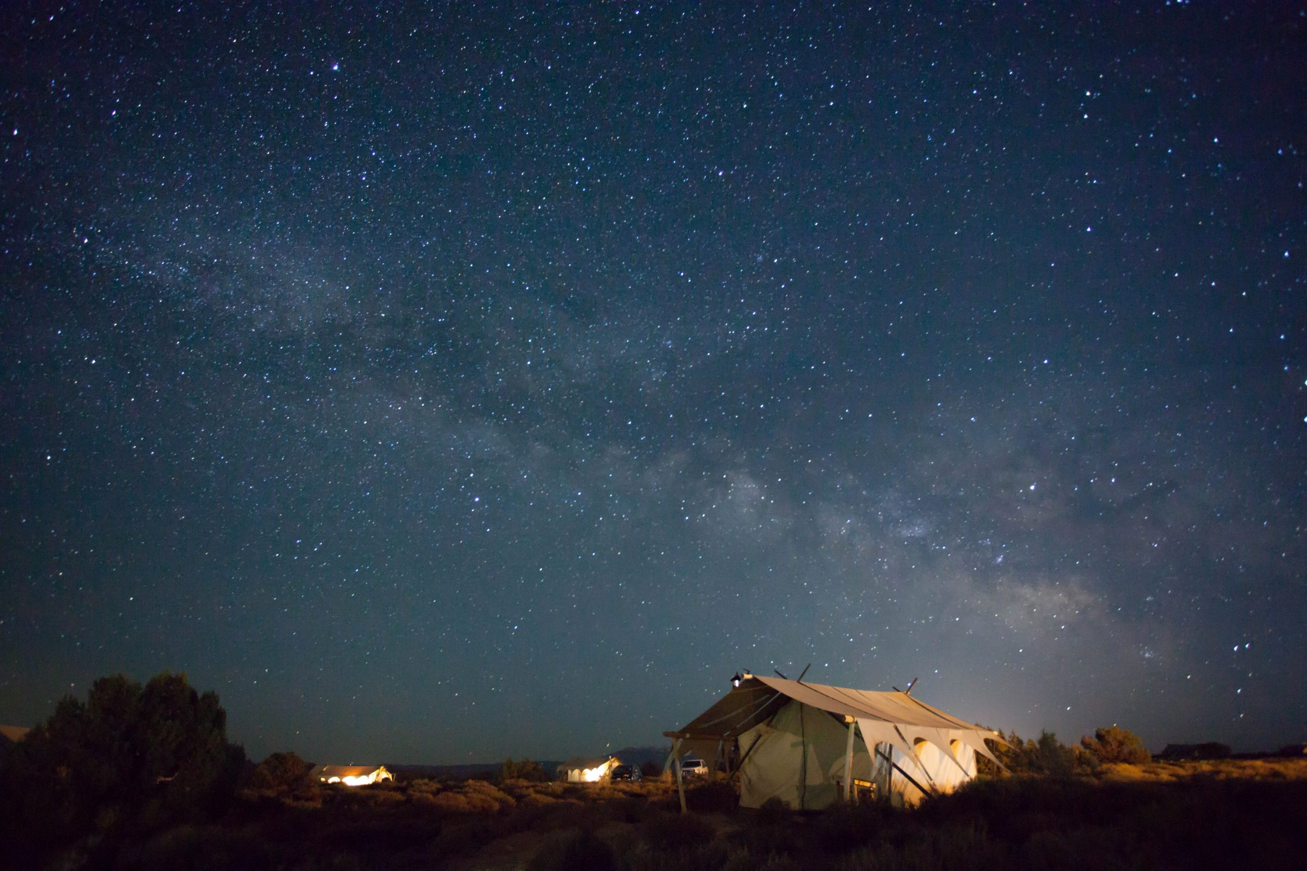 A large tent under a starlit sky