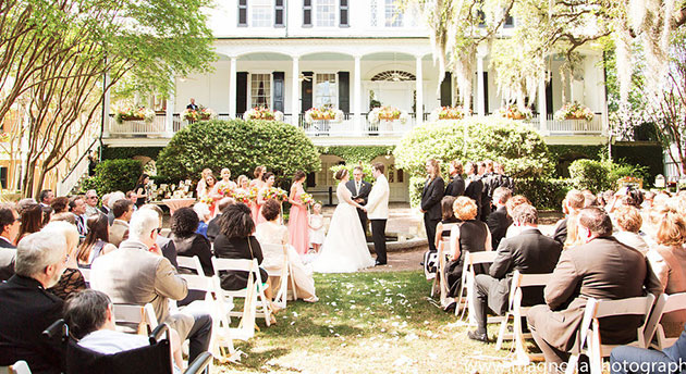 couple getting married in front of historic Charleston home