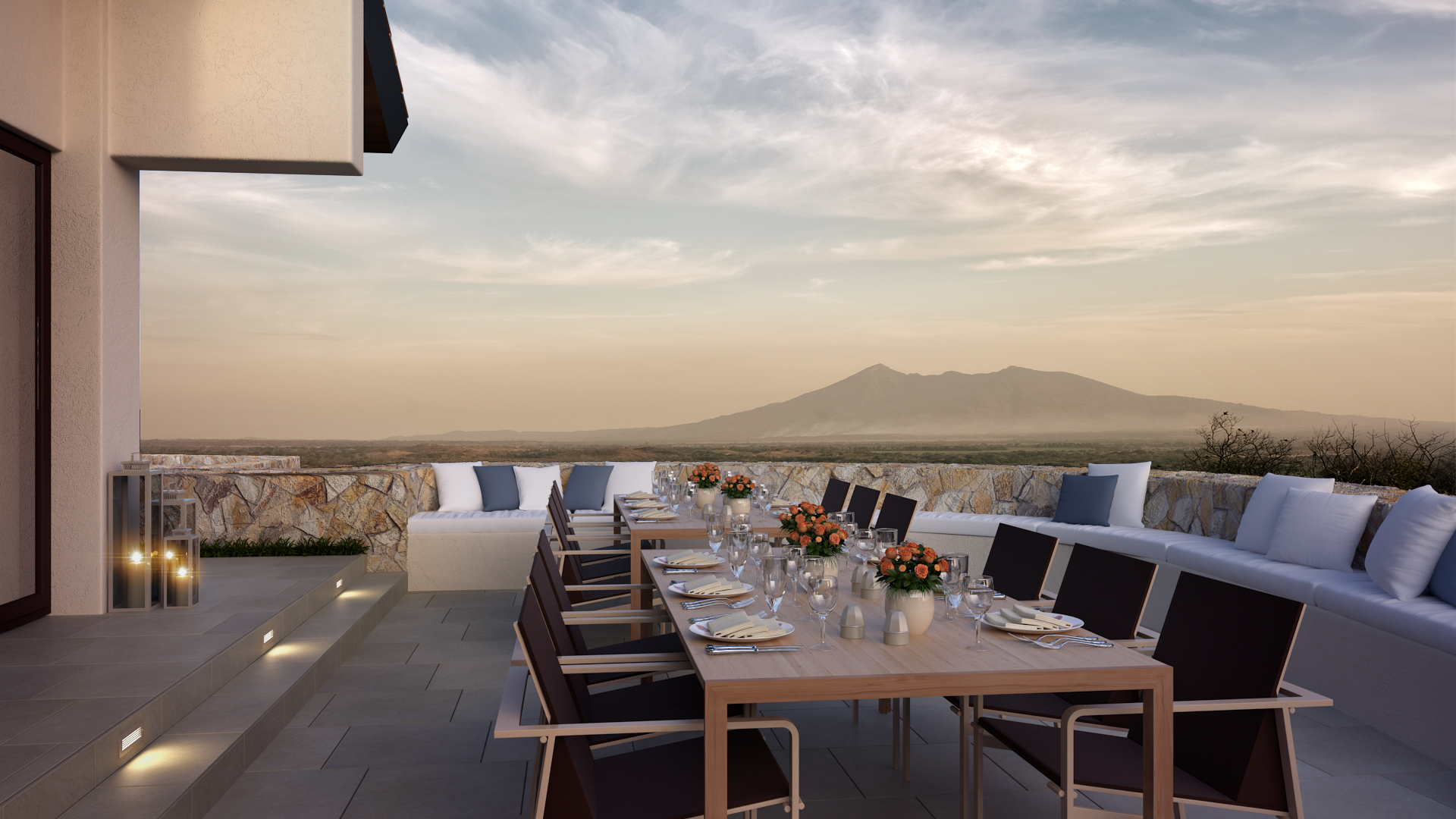 outdoor patio seating with moutain silhouette in background