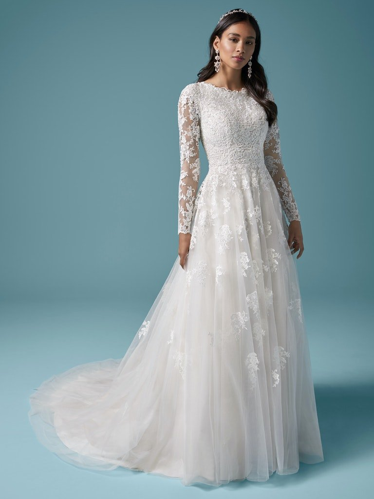 woman in all lace a-line bridal gown with illusion lace sleeves