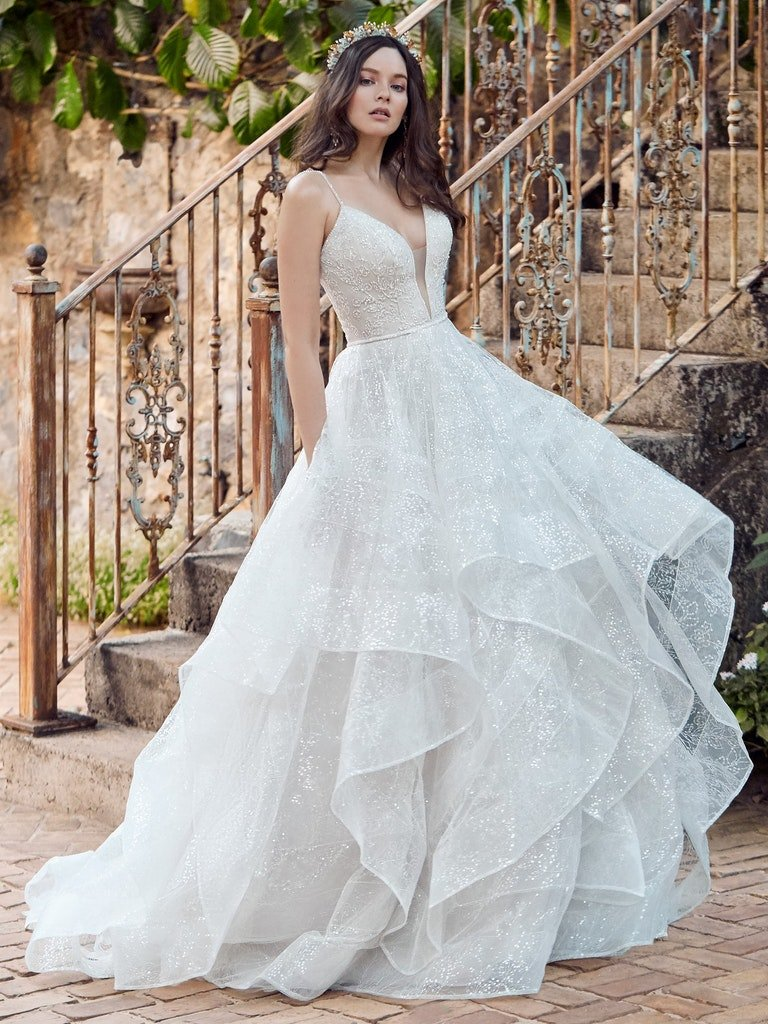 woman in large tulle ball gown wedding dress with ruffled skirt