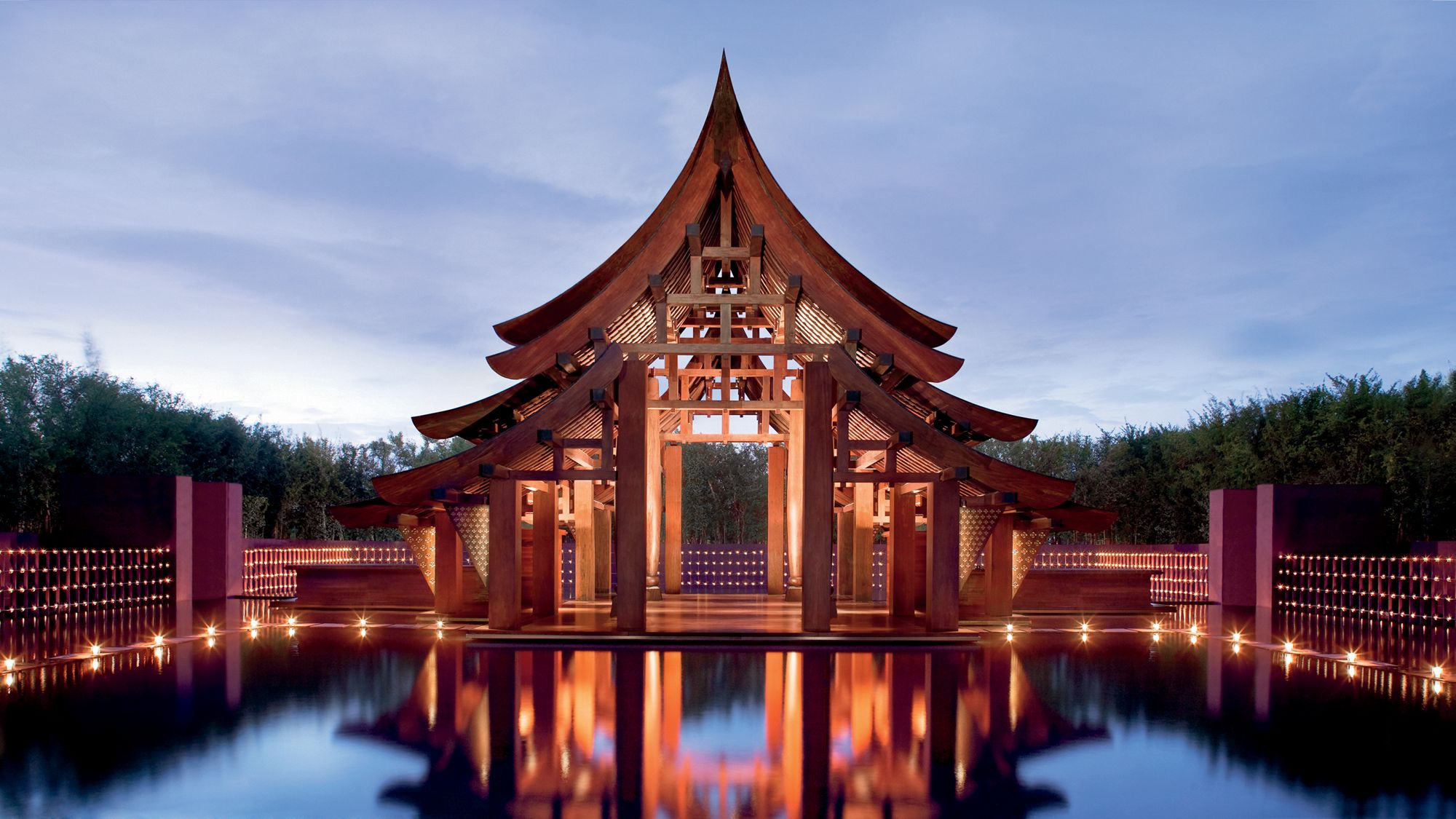 pagoda-style welcome pavilion next to a reflecting pool