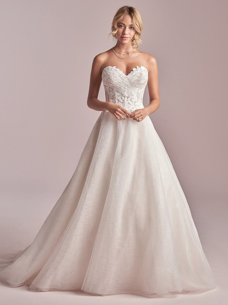 woman in strapless princess ball gown wedding dress with floral lace bodice