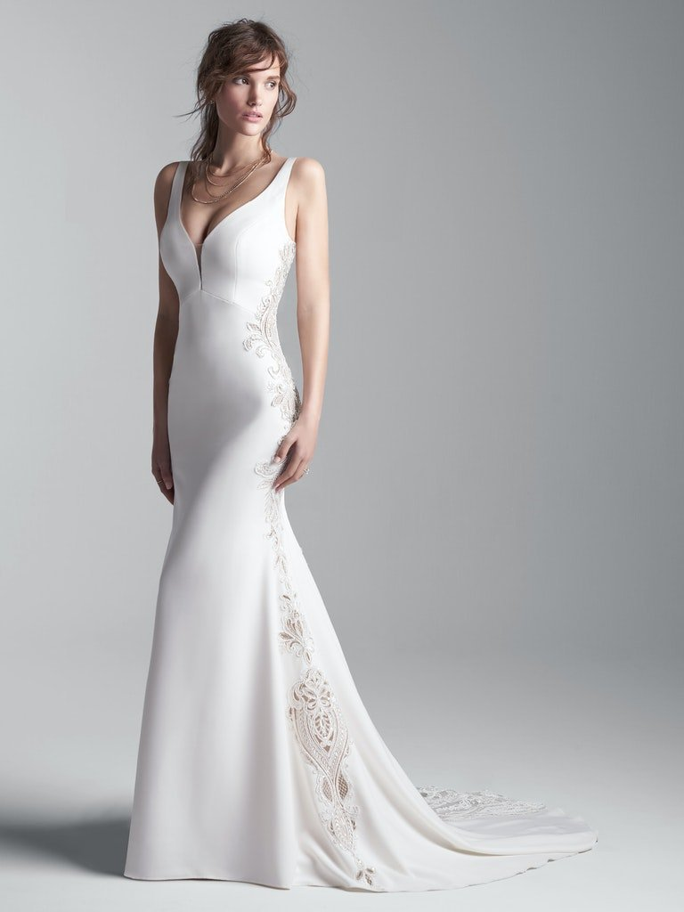 woman in sleeveless vintage wedding dress with illusion lace cut-outs
