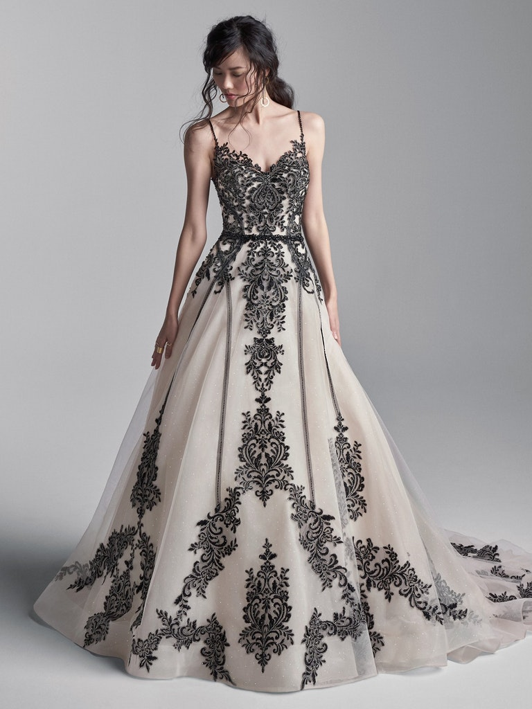 woman in nude wedding gone with black lace and bead detailing on bodice and skirt
