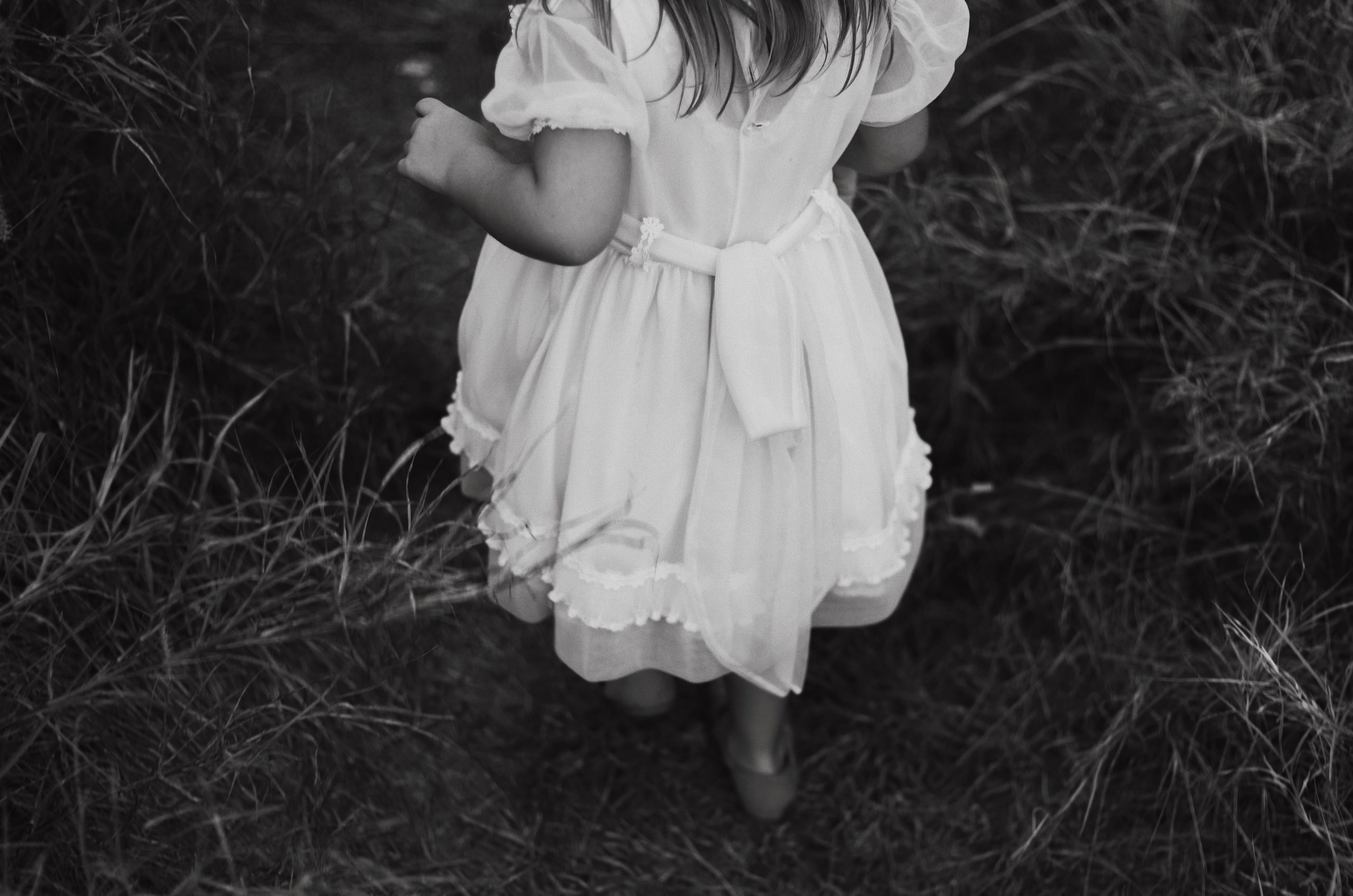 A little child in a white dress
