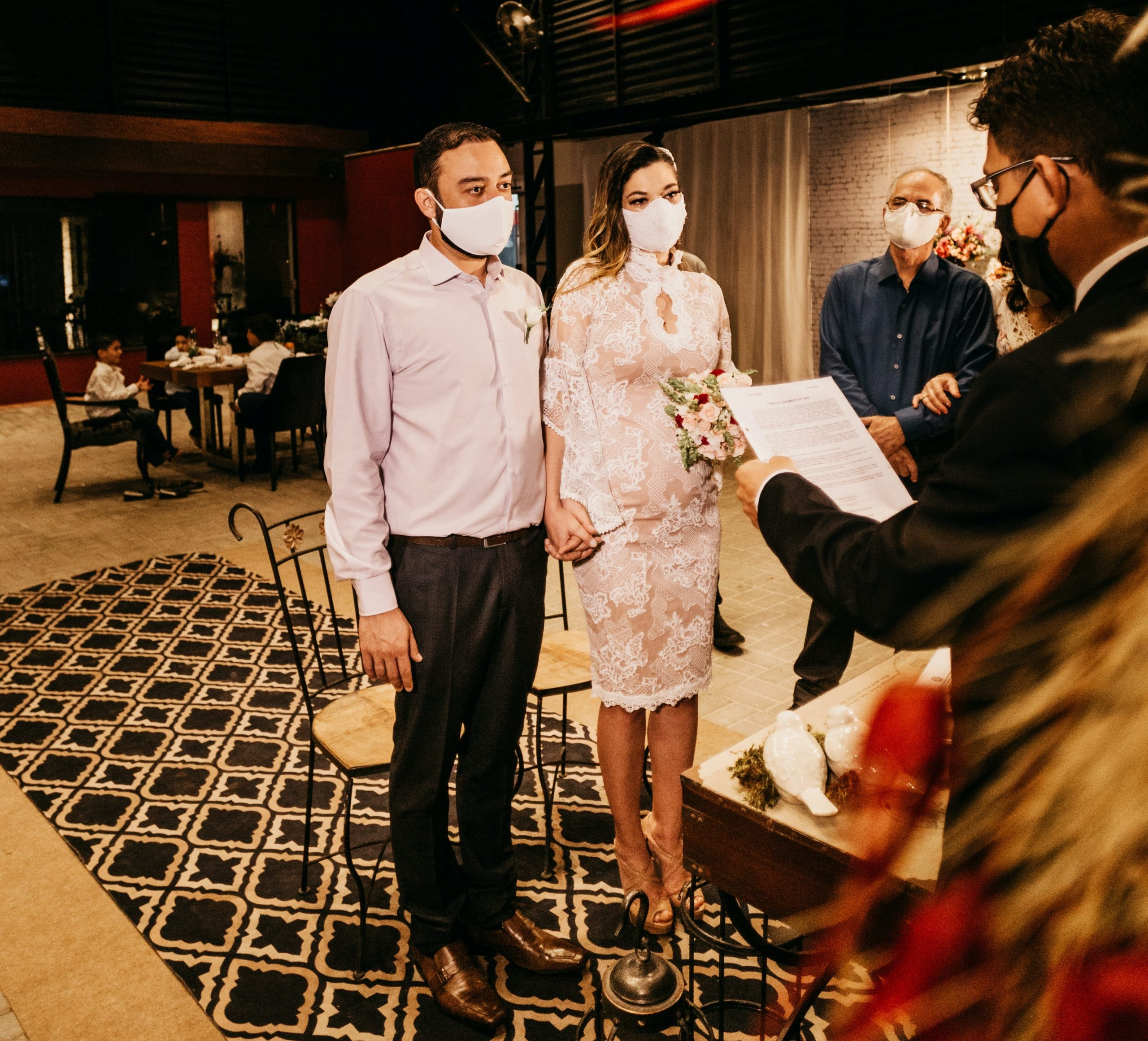 a couple eloping and wearing face masks