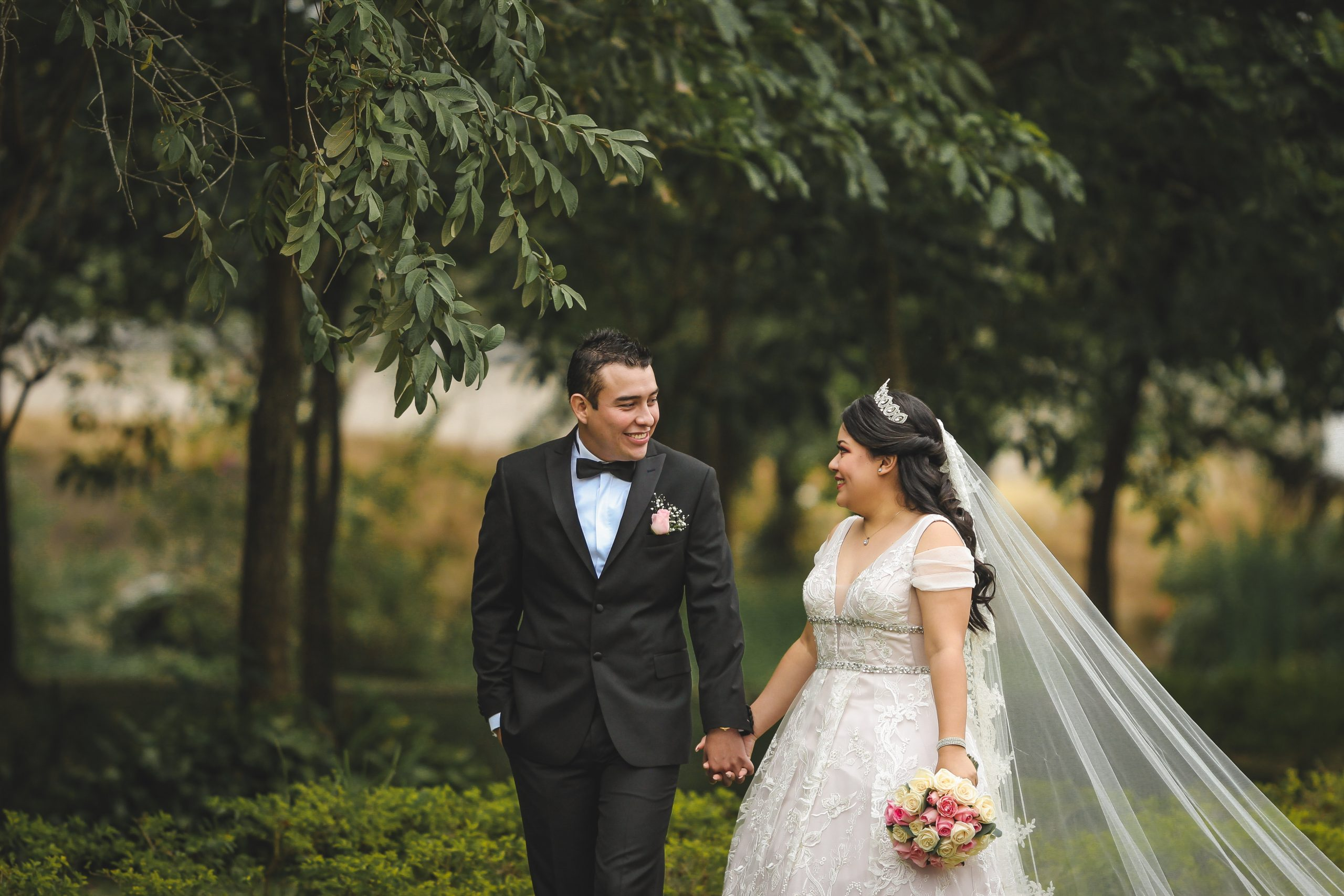 a couple eloping and holding hands