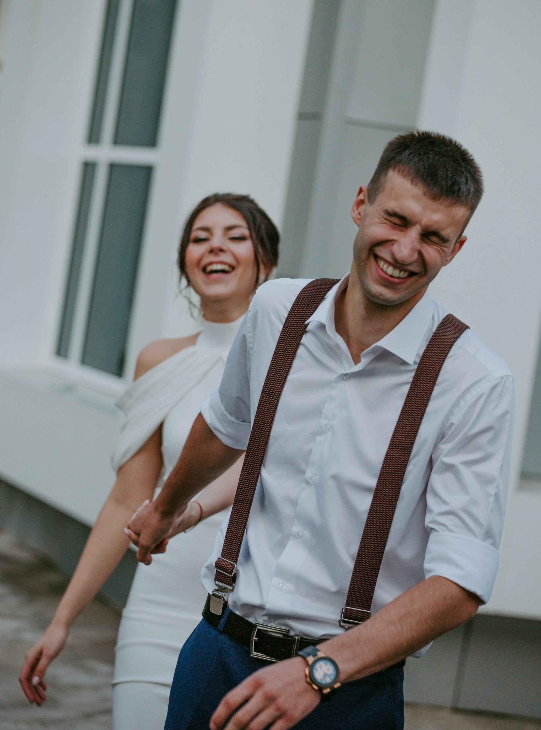 a couple eloping and laughing
