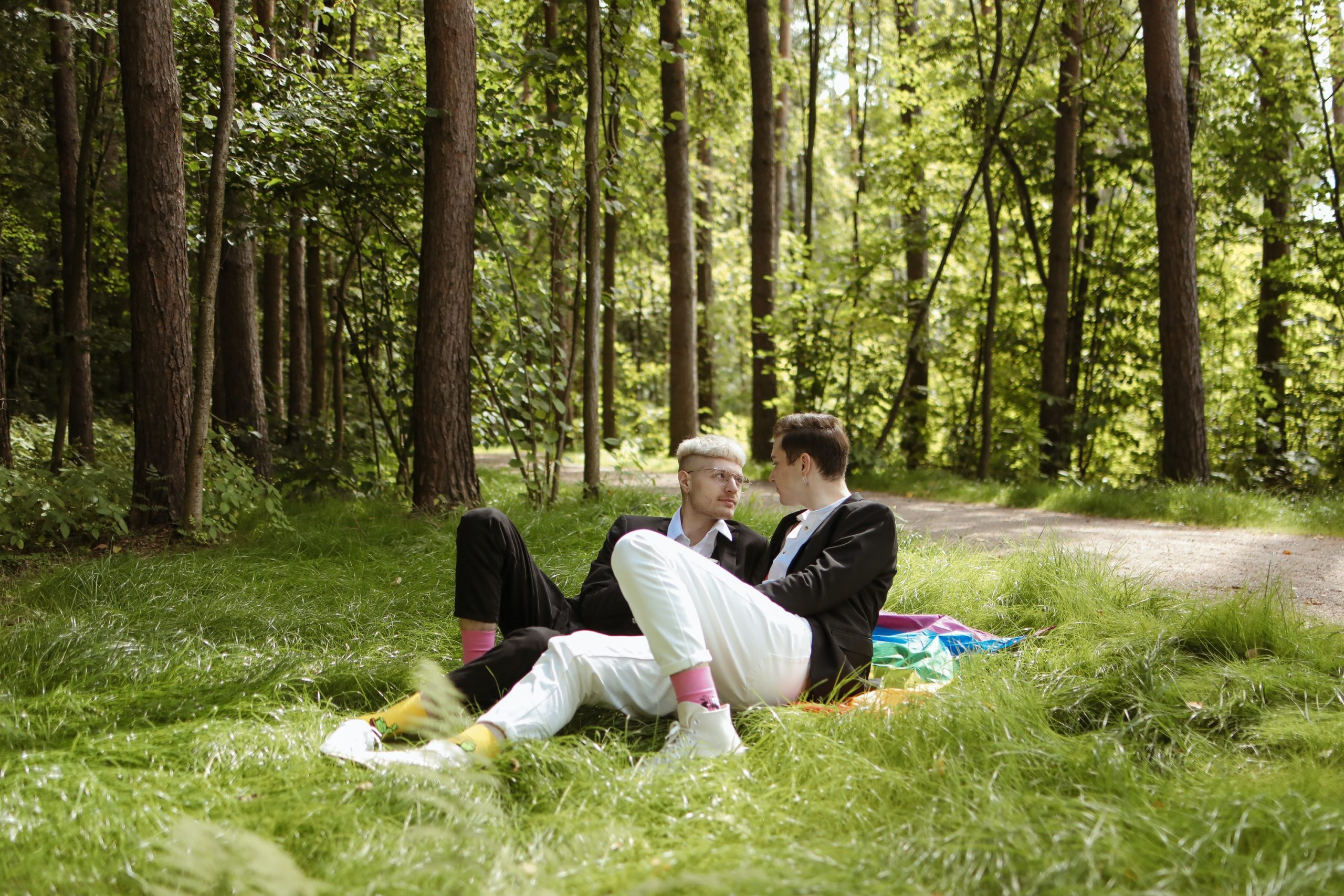 a couple eloping on a picnic blanket