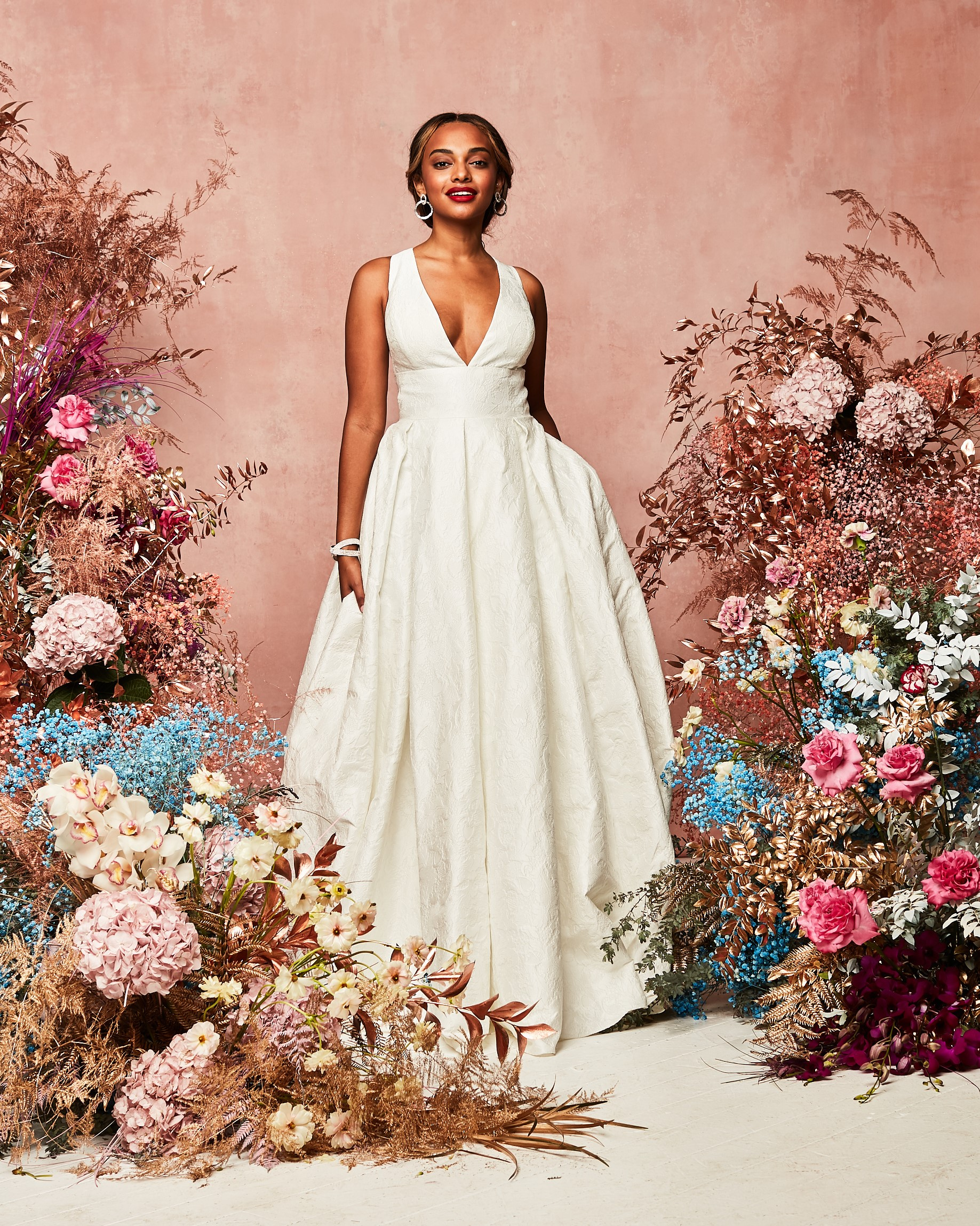 A deep V white bridal gown from david's bridal spring 2021 collection