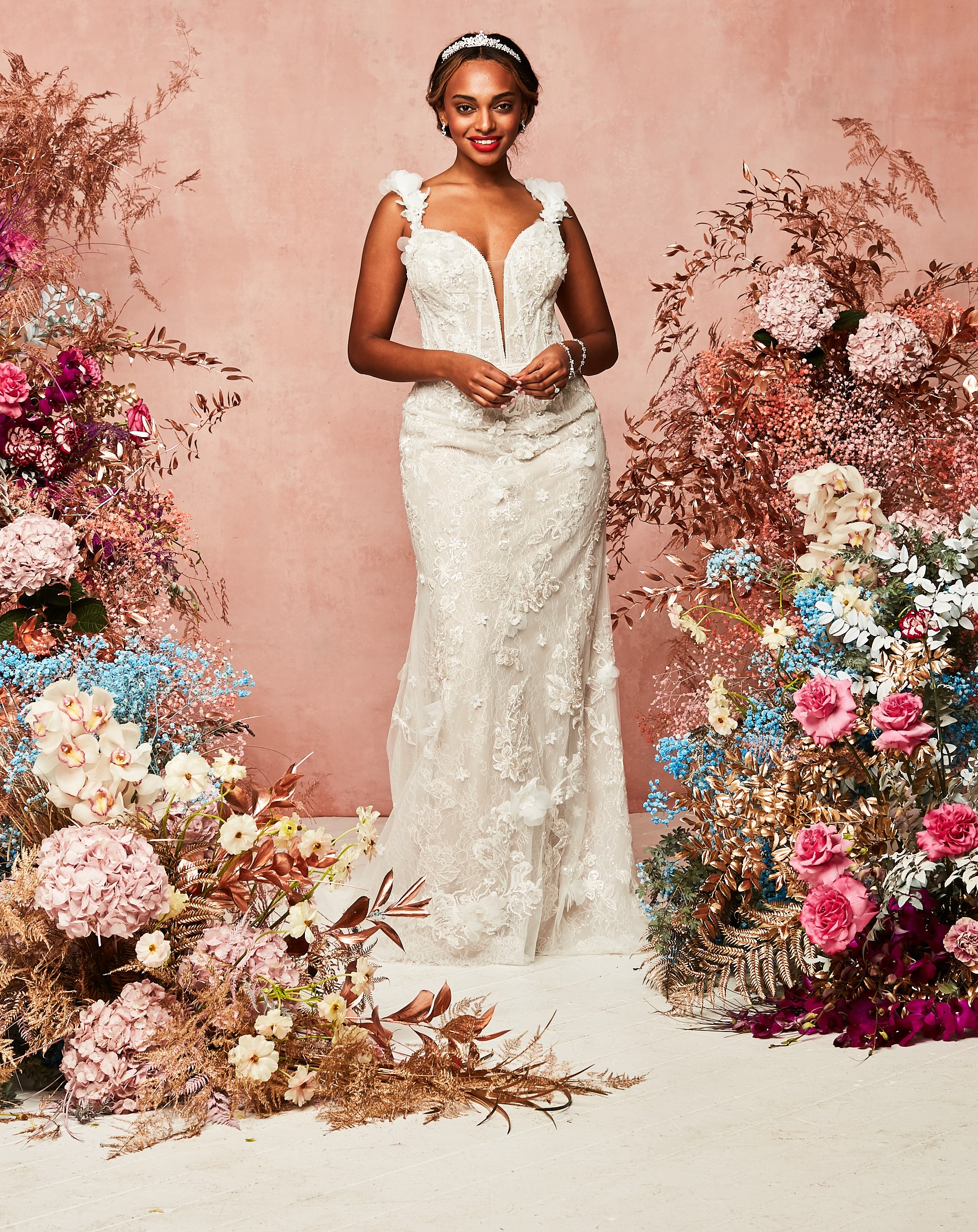 plunge neck gown with removable sleeves sporting both-shoulder look from David's Bridal Spring 2021 Collection