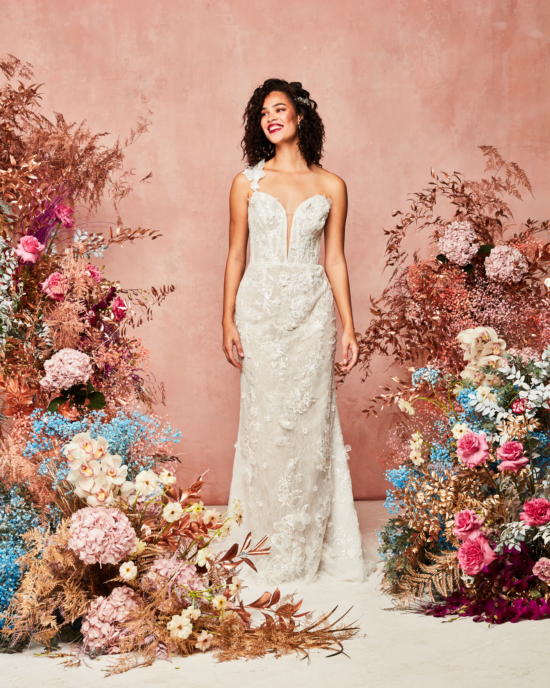 plunge neck gown with removable sleeves sporting one-shoulder look from David's Bridal Spring 2021 Collection